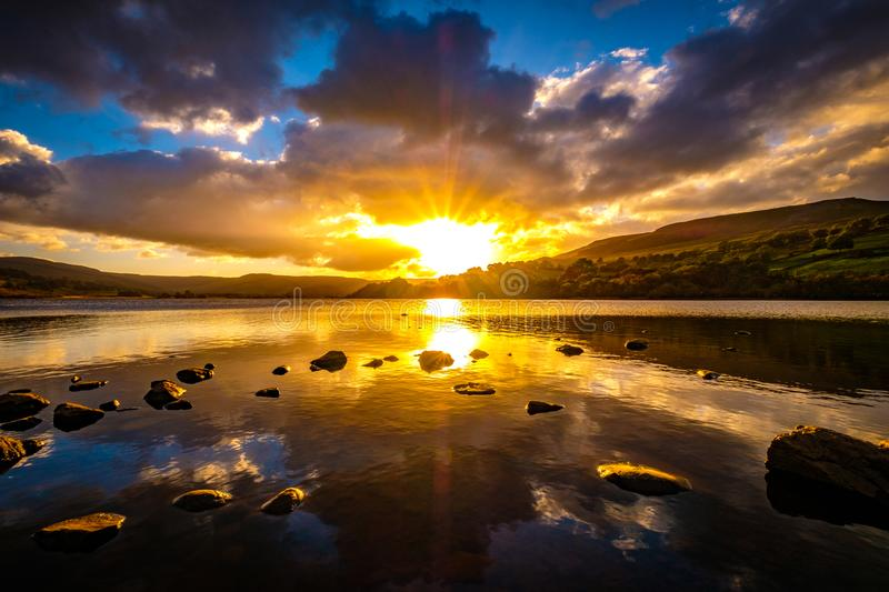 Semerwater in the Yorkshire Dales, England. The sun sets on Semerwater near Hawes in the Yorkshire Dales, England stock photo