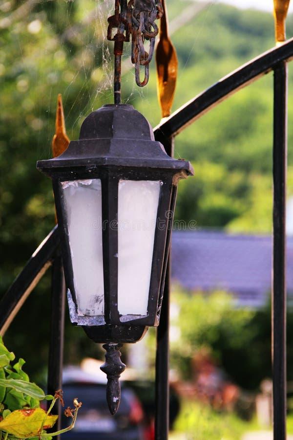 Semi-antique lantern in a web royalty free stock photo