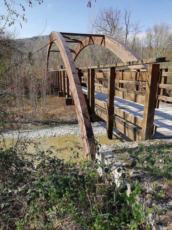 A wooden bridge with a semicircular wooden vault stock photos