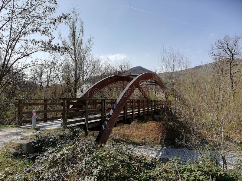 A wooden bridge with a semicircular wooden vault stock image