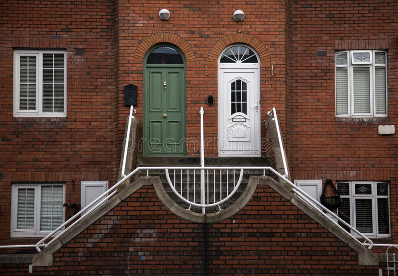 Semi detached house with typical irish doors stock images