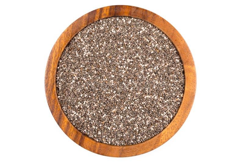 Semi di Chia in ciotola di legno fotografia stock libera da diritti