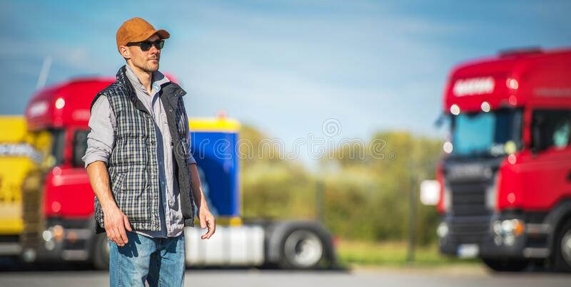 Semi Driver on Truck Stop. Transportation Industry. Caucasian Male Semi Truck Driver in His 30s on the Truck Stop royalty free stock photo