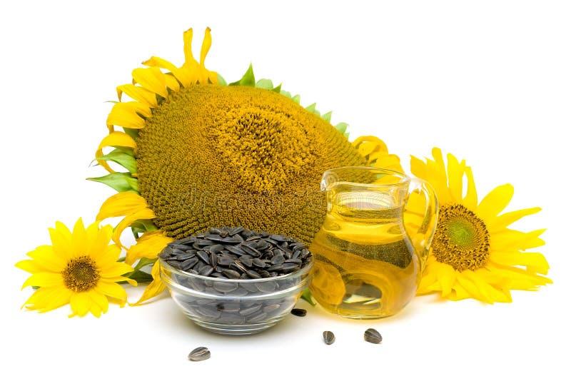Semi fiori ed olio di girasole su un fondo bianco for Semi di fiori