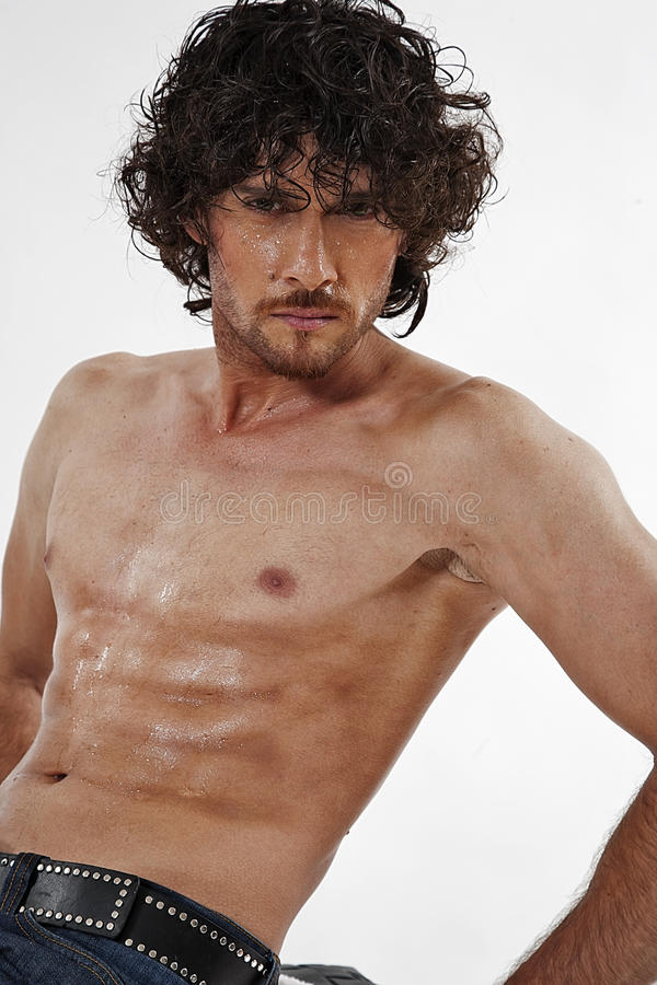 Semi nude portraits of handsome muscular man royalty free stock image