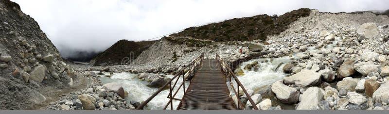 Semi panoramic view of the metal bridge leading to Thukla village stock images