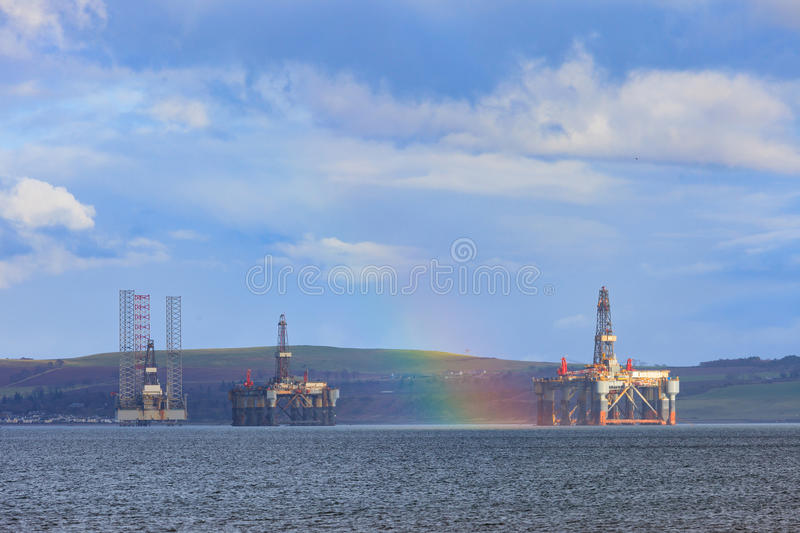 Semi Submersible Oil Rig and Rainbow at Cromarty Firth in Invergordon. Semi Submersible Oil Rig at Cromarty Firth in Invergordon, Scotland royalty free stock photography