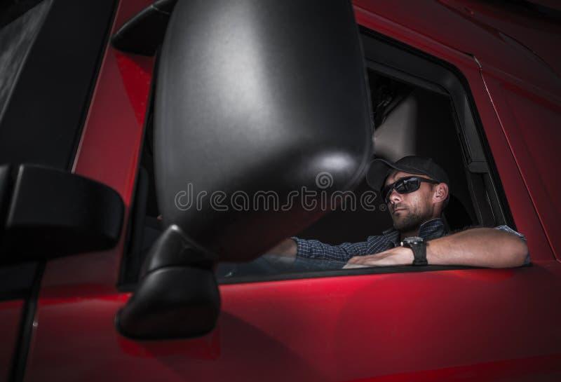 Semi Truck Driver Job. Truck Driver Job. Caucasian Driver in His Brand New Red Semi Truck Tractor royalty free stock photo