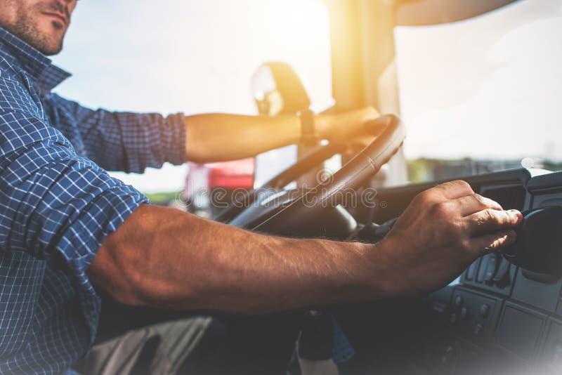 Semi Truck Driver Job. Caucasian Trucker Preparing For Long Haul Shipping stock photography