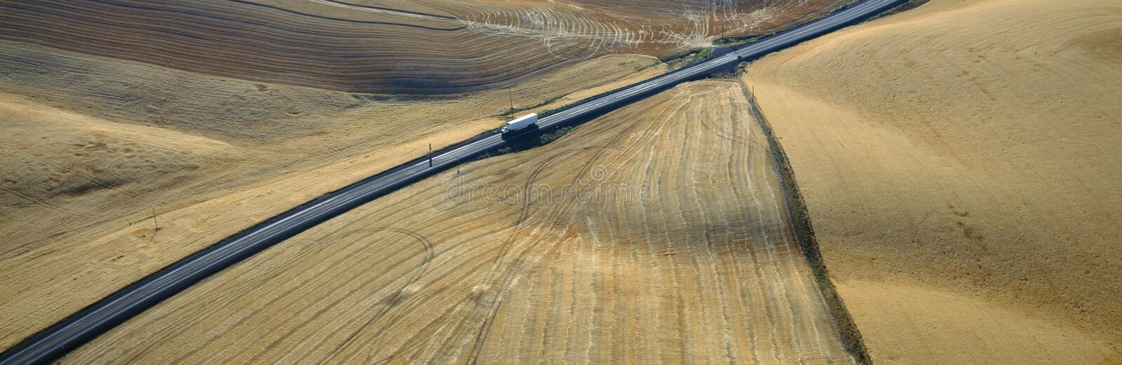 Download Semi-Truck Driving Through Wheat Fields Stock Image - Image: 23175461