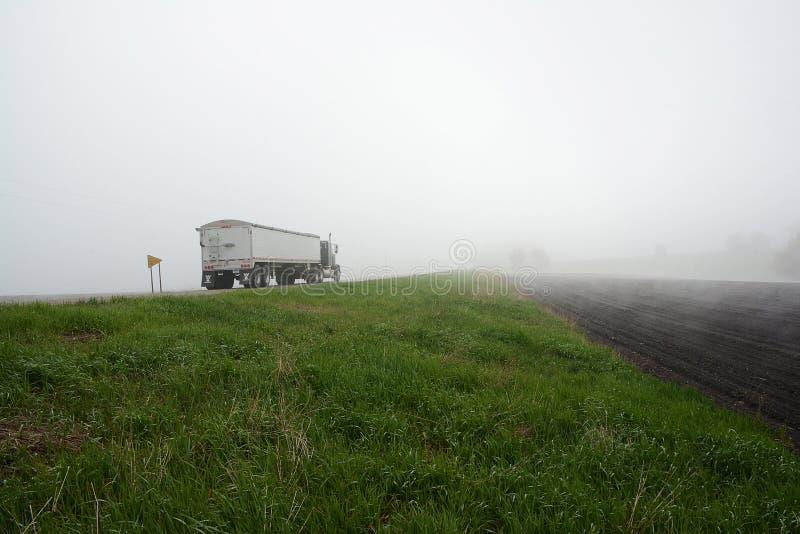 Semi Truck in Fog 2 stock photo