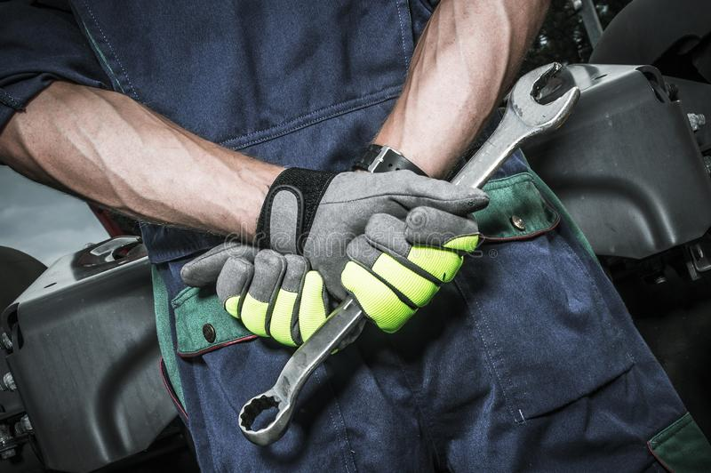Semi Truck Mechanic Concept. Semi Truck Caucasian Mechanic Concept Photo. Men with Large Wrench Crossing His Hands stock image