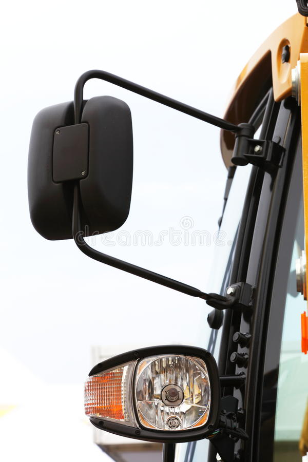 Semi Truck Mirror and Headlight Detail. The Image of Semi Truck Mirror and Headlight Detail royalty free stock photography