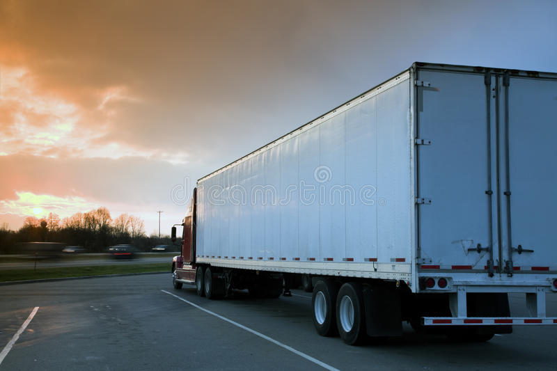 Semi Truck Parked on rest area. Sunset time - tobacco graduated filter used stock photo