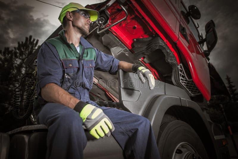 Semi Truck Pro Mechanic. Semi Truck Professional Mechanic Taking Short Break During His Work on the Broken Euro Tractor Truck stock images