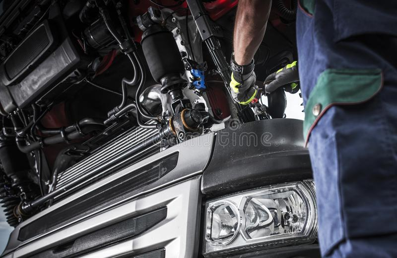Semi Truck Problem Diagnostic. Modern Semi Truck Problem Diagnostic. Caucasian Truck Mechanic Doing His Best to Fix the Truck royalty free stock images