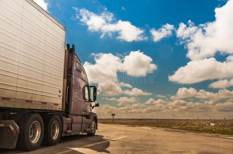 Semi truck on the rest area. Big semi truck stay on the rest area in the sunny day stock image