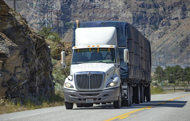 Semi truck with trailer driving on highway royalty free stock photo