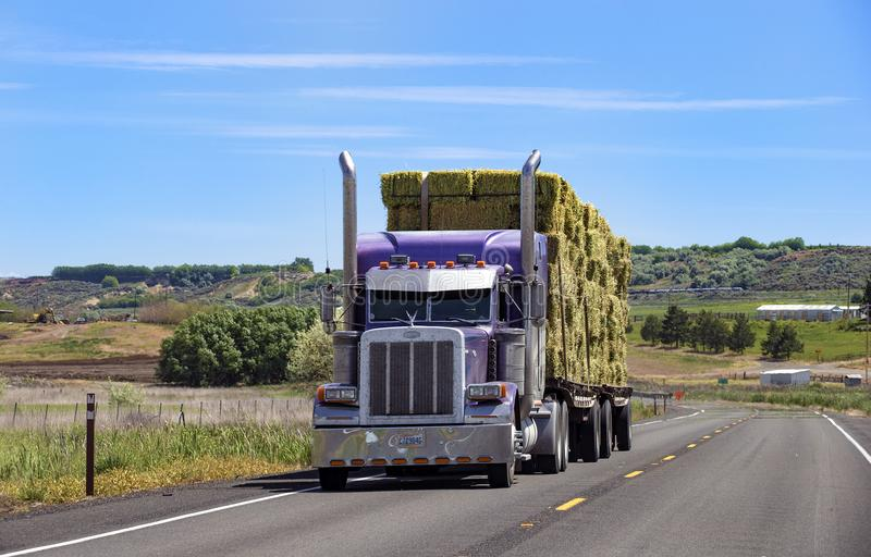 Semi truck with trailer driving on highway stock photos