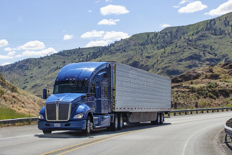 Semi truck with trailer driving on highway royalty free stock image