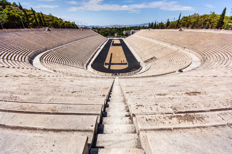 Semicircle of ancient stands. And in the center of treadmills, central, symmetrical composition image,with the track down to the stadium in the center of the stock image