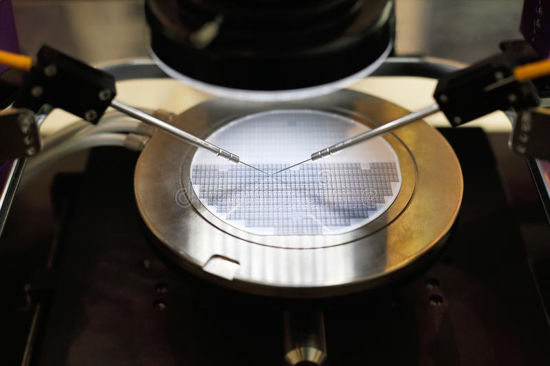 Semiconductor silicon wafer undergoing probe testing royalty free stock photo