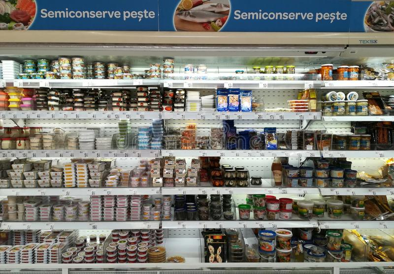 Canned fish on the shelves at the supermarket stock image