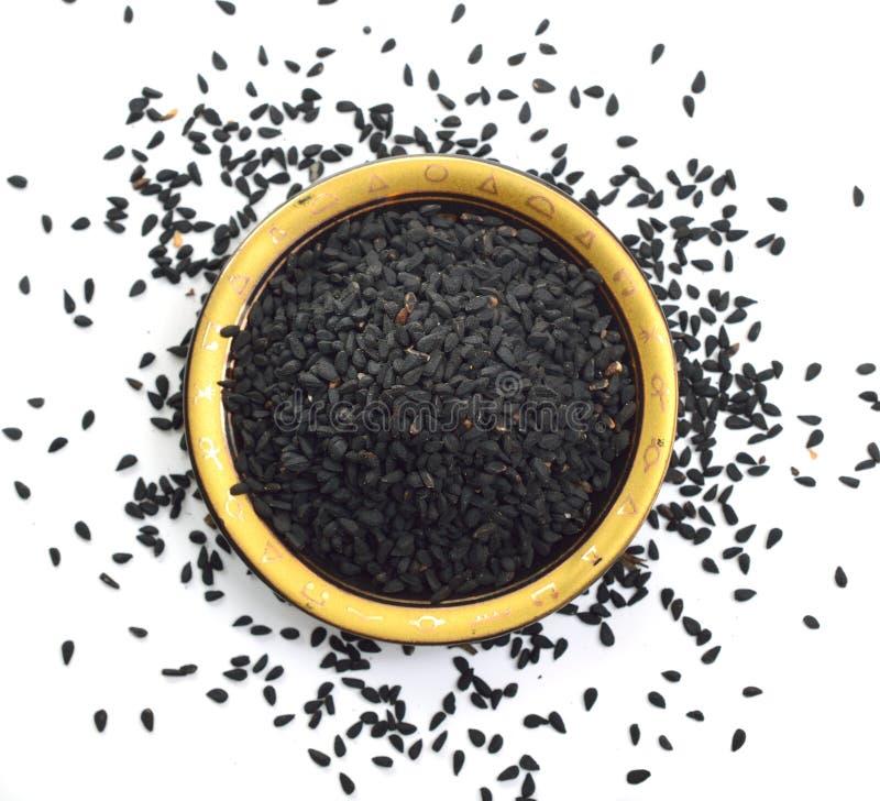 Semilla de Nigella sativa o de la flor de hinojo, flor de nuez moscada moscada, alcaravea negra, coriandro romano, comino negro,  foto de archivo