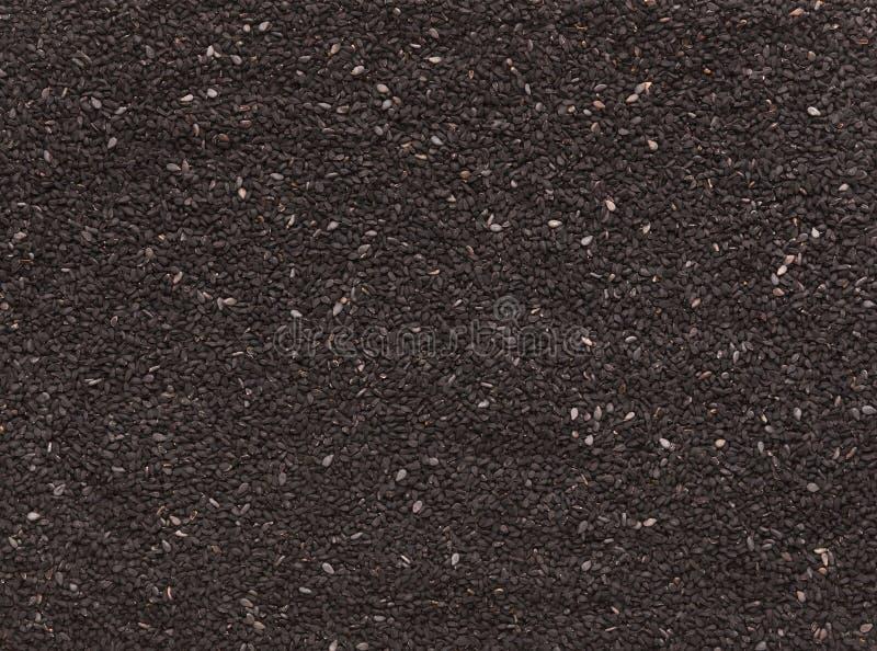 Semillas de sésamo negras textura, fondo culinario abstracto imagenes de archivo