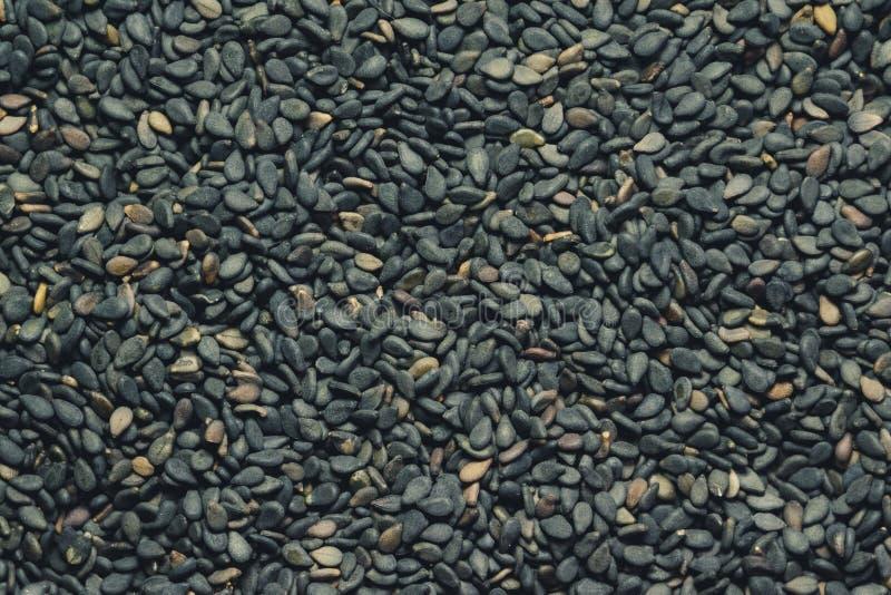 Semillas de sésamo sin pelar negras cerca para arriba, fondo foto de archivo libre de regalías