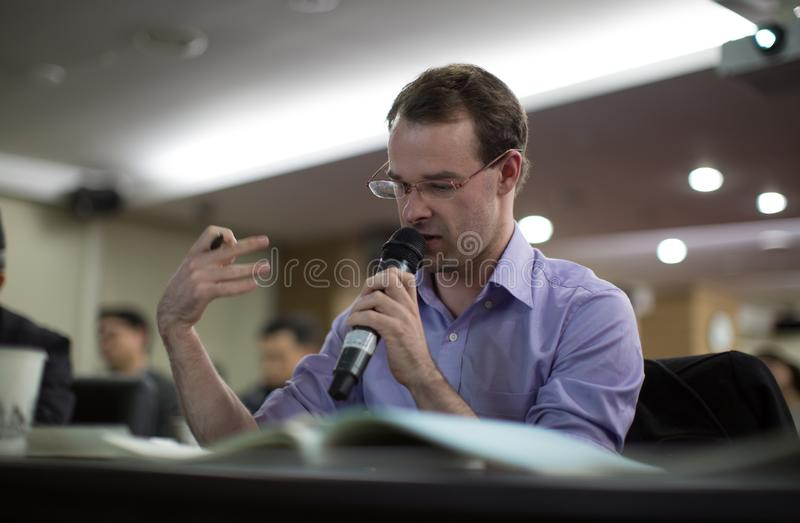 Seminar presenter at corporate conference giving speech. Speaker giving lecture to business audience. Executive manager leading di royalty free stock photo