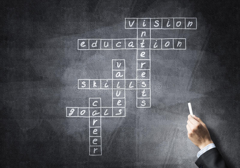 Seminar trainer draw on chalkboard. Business concept with crossword drawn with chalk on blackboard royalty free stock image