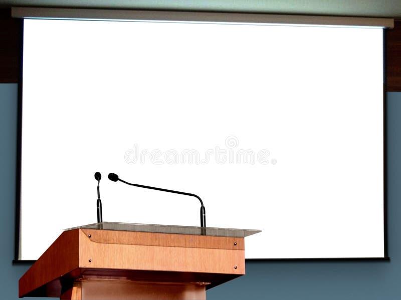 Seminariumpodium med den tomma skärmen arkivbilder