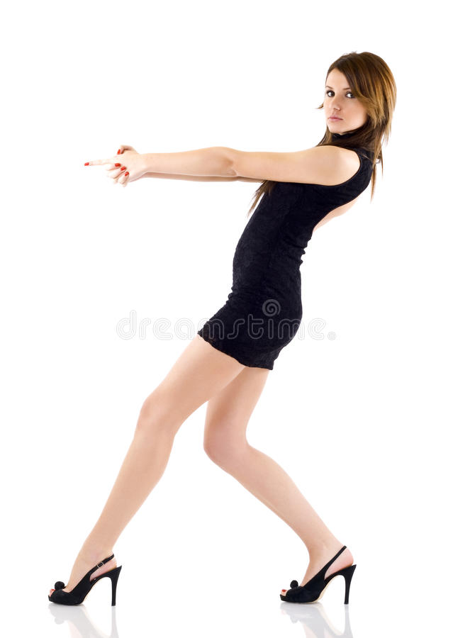 Seminude girl aiming with two hands. Dark-haired seminude girl aiming with two hands over white royalty free stock photo