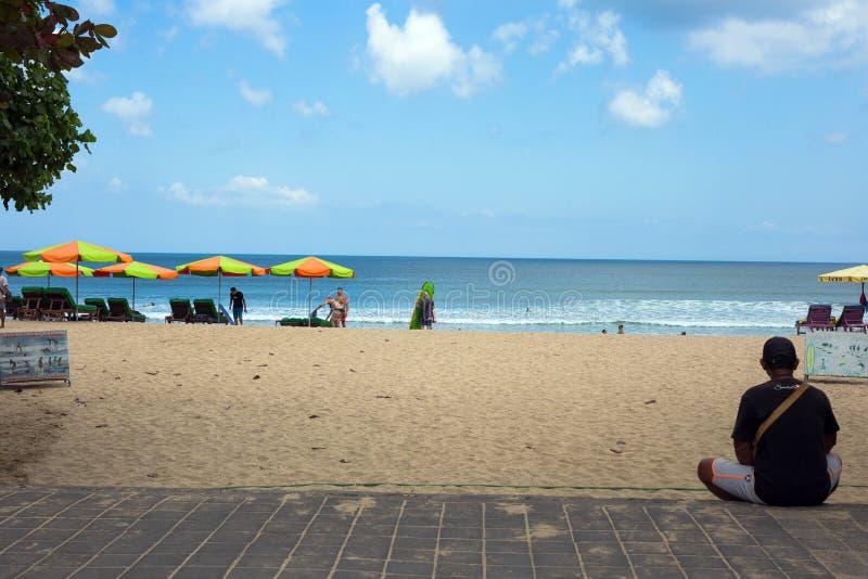 Seminyak, Bali Sep 20 Wide sand beach with tourists, near Kuta Indonesia. Bali royalty free stock photos