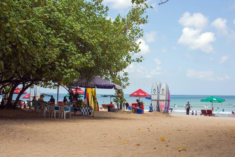 Seminyak, Bali Sep 20 Wide sand beach with tourists, near Kuta Indonesia. Bali stock image