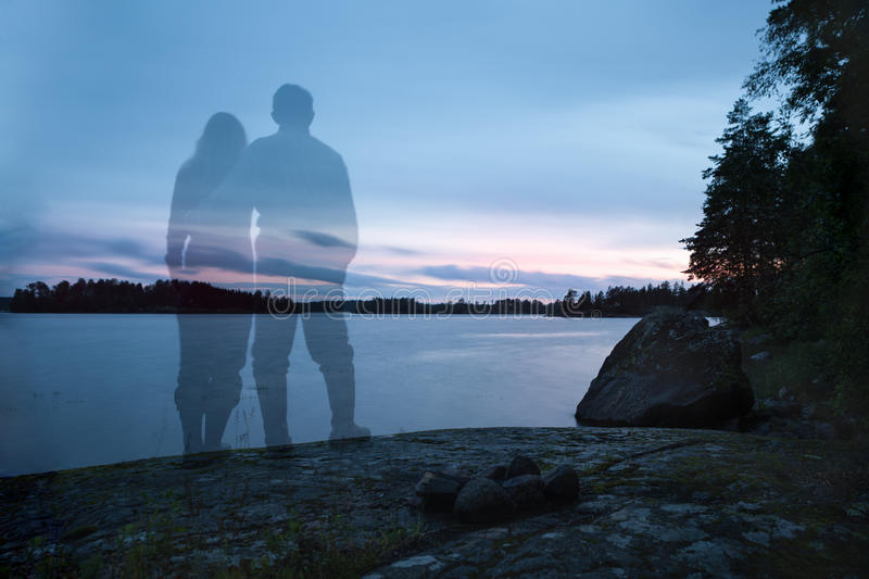 Two lovers on a rocky bank royalty free stock images