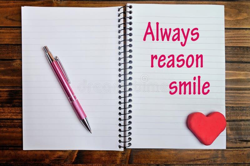 Sempre palavras do sorriso da razão fotos de stock