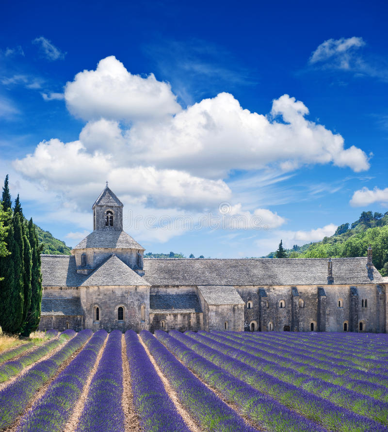 Senanque abbey with lavender field, landmark of Provence, Vaucluse. France. Beautiful landscape with medieval castle and cloudy blue sky royalty free stock photography