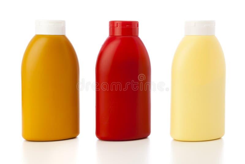 Senap, ketchup och mayonnaise royaltyfria foton