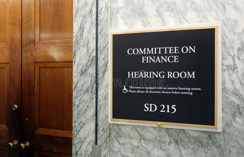 Senate Finance Committee. Washington, DC, USA - July 18, 2017: A sign at the entrance to a Senate Finance Committee hearing room. The United States Senate is the stock photography