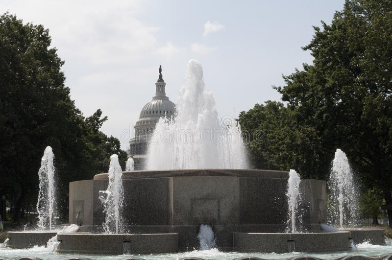 The Senate Fountain and the United States Capital Building. An image of The Senate Fountain and the United States Capital Building in Washington DC royalty free stock images
