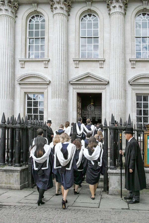 Senate House. Students from Trinity college, Cambridge, England, enter Senate House to receive their degree certificates on 25 june 2014 royalty free stock photo