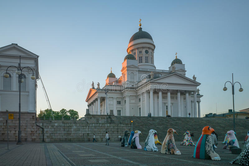 Senate square and the Lutheran Cathedral, in Helsinki. HELSINKI, FINLAND - JUNE 15, 2017: Sunset scene in the Senate square and the Lutheran Cathedral, with a royalty free stock image