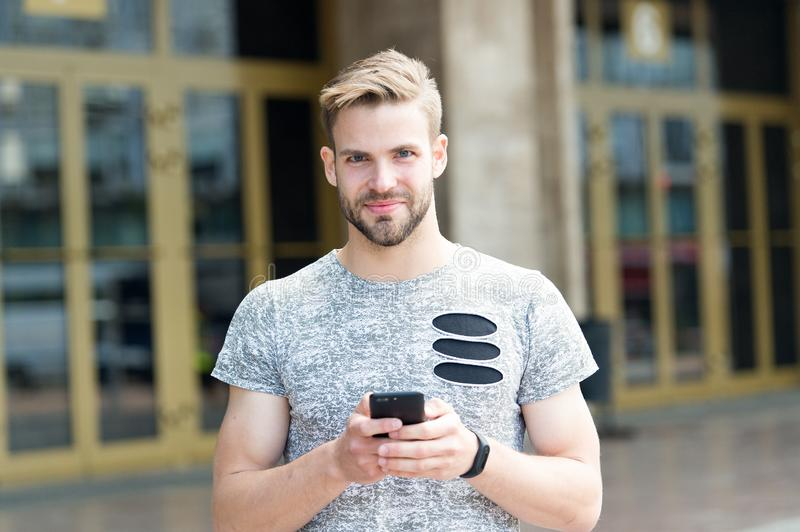 Send email. Responding message. Download application. Man hold smartphone building background. Man messaging online royalty free stock photography