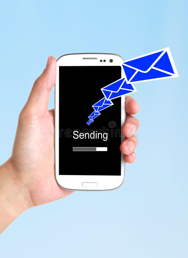 Send message. Hand holding smartphone. Sending new text message concept stock photo