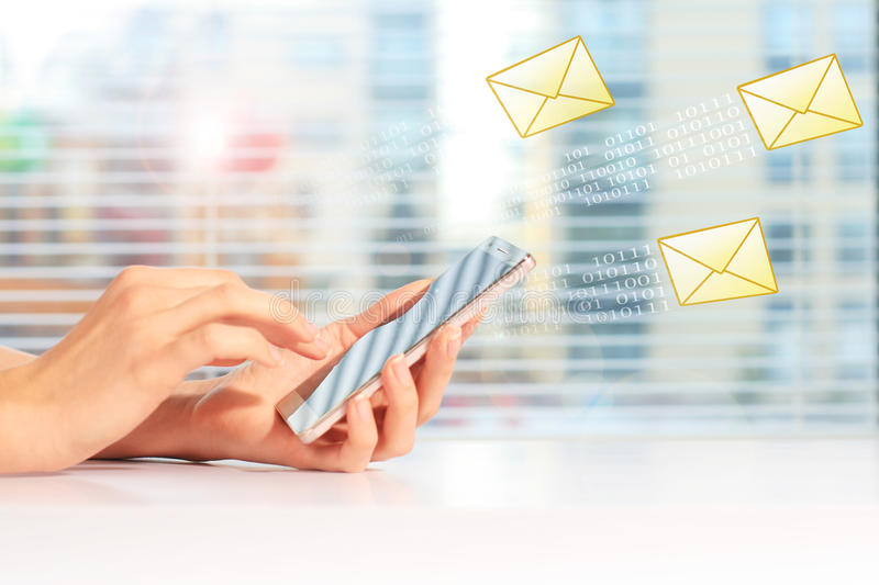 Send SMS message. Send free SMS message on mobile phone stock photography