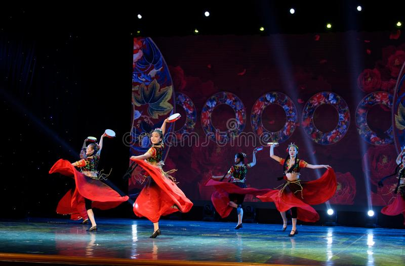 Send you a rose 1 -Chinese national dance in Xinjiang. It is a dance widely distributed in the Uygur ethnic group, accompanied by the music of the king of the stock images