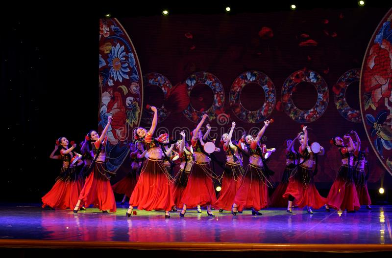 Send you a rose 3 -Chinese national dance in Xinjiang. It is a dance widely distributed in the Uygur ethnic group, accompanied by the music of the king of the stock images