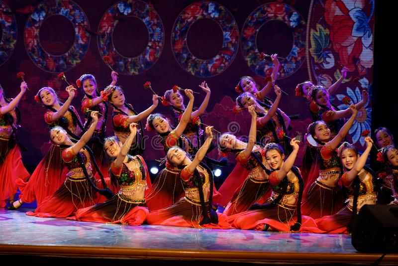 Send you a rose 4 -Chinese national dance in Xinjiang. It is a dance widely distributed in the Uygur ethnic group, accompanied by the music of the king of the stock image